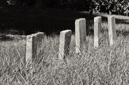 A row of unmarked small child headstones horizontal Stock Photos