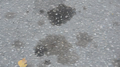 Oil spot on concrete leaked from vehicle Stock Footage
