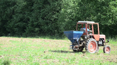 Special agriculture heavy machine sow buckwheat seeds in field Stock Footage