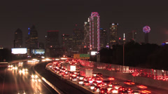 Dallas Skyline at night w/highway traffic. w/ SMU in Lights Stock Footage