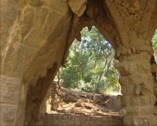 Park Guell - view from the viaduct path to the park + pan stone columns Stock Footage