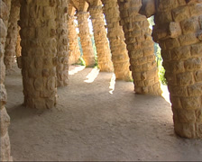 Park Guell - tilt up inclined stone columns of the viaduct path, Antoni Gaudi Stock Footage