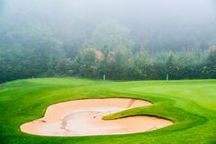 Sand bunker on the golf course. Mexican resort. Bahia Principe, Riviera Maya. Stock Photos