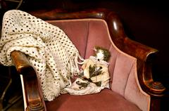 doll on antique chair - stock photo