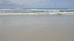 Waves lapping beach Stock Footage