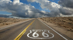 Route 66 with Time Lapse Clouds Stock Footage
