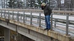 Depressed man on the bridge episode 1 Stock Footage