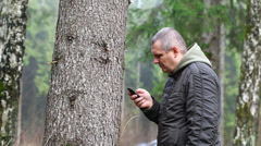 Depressed man leaning on a tree episode 1 Stock Footage