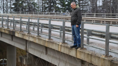 Depressed man on the bridge episode 2 Stock Footage