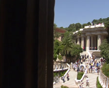 View from Gatehouse at Park Guell with stairway to main terrace + pan park Stock Footage