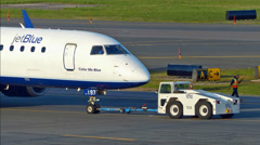 JetBlue airplane towed, zoom in - still Stock Footage