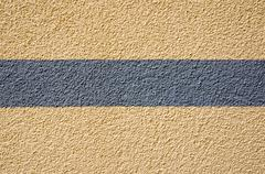 Yellow plaster with a grey stripe Stock Photos