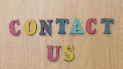 CONTACT US  - Word Appearing Letter by Letter Stock Footage