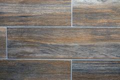 Brown tiled wall - stock photo