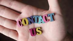 CONTACT US Letters In Hand Stock Footage