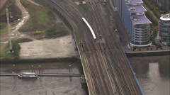 Passenger train crosses the river Thames in London as it heads into the station - stock footage