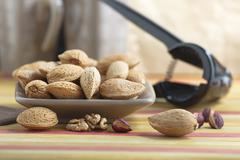 Almonds with kernel Stock Photos