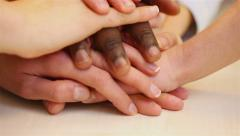 Teenager stacking hands for teamwork Stock Footage