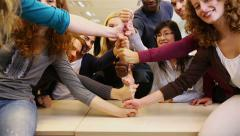 students stacking fists in school - stock footage