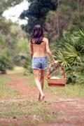 pretty seminude brunette outdoors (2) - stock photo