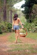 pretty seminude brunette outdoors (3) - stock photo