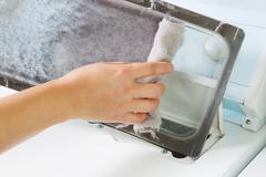 taking the lent of dryer machine - stock photo