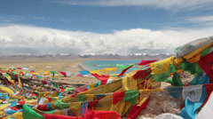 Fluttering Tibetan prayer flags with Lake Namtso, Tibet, China Stock Footage