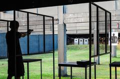 Men shooting at gunnery drills Stock Photos