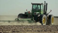Tractor ploughing field on farm. - stock footage