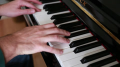 man playing a song on the piano - stock footage