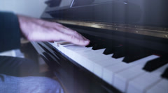 Stock Video Footage of a male playing a song on the piano