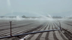 Farm sprinklers on neatly graded crop beds. Stock Footage