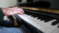 Stock Video Footage of a man playing the piano