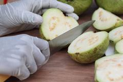 cutting fresh guava - stock photo