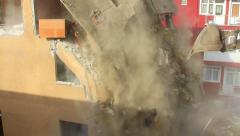 Bulldozers turn old homes into rubble and dust fills the air Stock Footage