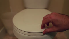 hand lifting the toilet lid - stock footage