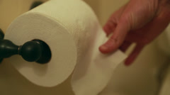 Stock Video Footage of a hand grabbing toilet paper