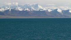 Mt.Nyainqentanglha and Lake Namtso, Tibet, China Stock Footage