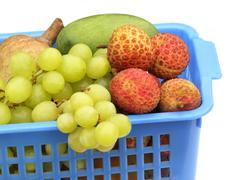 fresh fruits on a plastic basket - stock photo