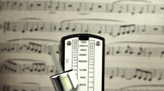 Classical music and metronome Stock Footage