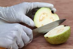 Stock Photo of cutting fresh guava