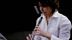 Young musician woman playing oboe Stock Footage