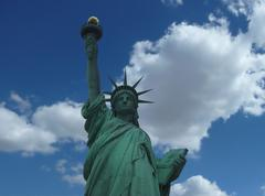 new york, jun 13: statue of liberty at the entrance of the harbor in nyc - stock photo