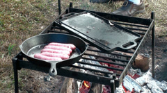 Cooking outdoors Stock Footage