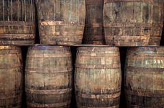 stacked old whisky barrels - stock photo