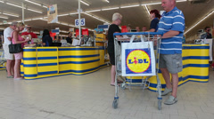 Customers buying goods in Lidl discount store in Paphos, Cyprus. Stock Footage