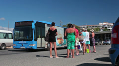 Vacationers awaiting departure bus on stop of Coral Bay beach, Paphos, Cyprus Stock Footage