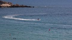 Riding in jet ski in Mediterranean sea in Coral Bay resort, Paphos, Cyprus - stock footage