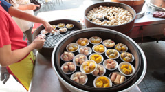 Dim Sum Being Served in Chinese Restaurant in Kuala Lumpur Stock Video Stock Footage