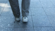 Stock Video Footage of An old man slowly moves his feet while walking